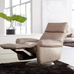 comfy recliners that don't look like recliners combined with brown rug and white tile for flooring in modern living room  ideas