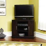 corner TV desk with storage system underneath wood planks floors yellow wall paint color