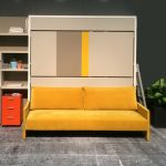 dream sofa that turn into bed design with bookshelves idea in yellow tone with orange file storage on gray industrial floor with potted plant