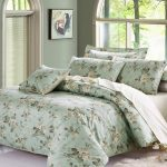 Eclectic Soft Green Bedding With Floral Patterned Cotton Sheet Beneath Arched Window Design In Gray Room For Tropical Appeal