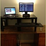 elegant clasic homemade standing desk design with extended black colored wood with double computer set beneath white wall