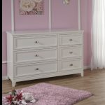furniture shipping quote for baby wooden dresser with purple rug and picture on purple wall and wooden floor plus window with sheer
