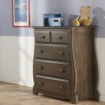 Furniture Shipping Quote For Wooden Dresser In Nursery Bedroom With Doll And Wooden Floor And Picture On Gray Wall