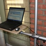 gorgeous homemade standing desk design beneath red brick wall aside glass window with standing storage