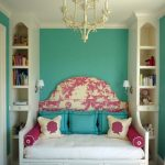 gorgeous tosca sofa that turn into bed with awesome headboard and pink accent and chandelier and tall recessed storage