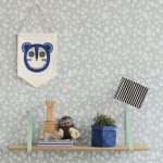 gorgeous wall decoration idea of ferm living usa with wooden mounted wall rack with flas and potted plant and owl and unique bag