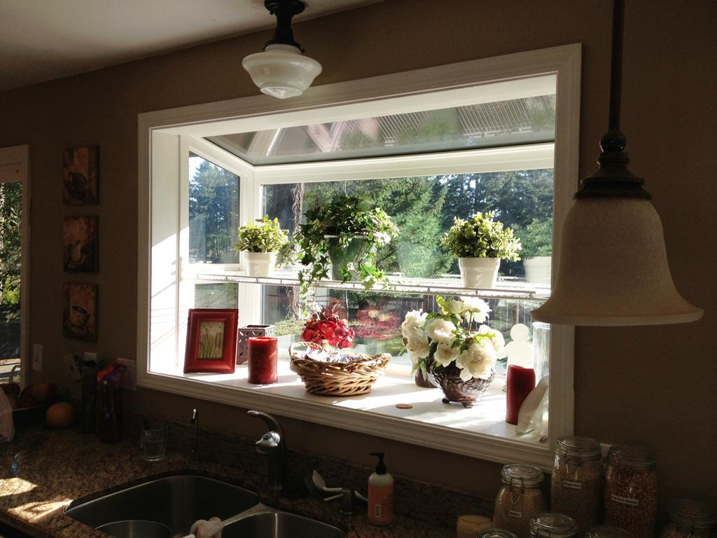 Greenhouse Windows For Kitchen Above Sink Beautified With Green Plants And Flower Plus Candle