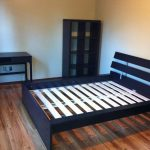 ikea assembly service nyc for bedroom with wooden bed frame and bookcase plus desk and drawer dresser and wooden floor