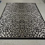 leopard black and gray area rugs for home ideas decorated on white floor and dark wooden cabinets