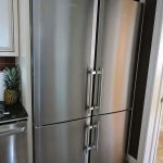 luxurious and amazing stainlesss steel double wide refrigerator idea in a kitchen set with white cabinet and small tile floor