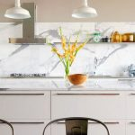 luxurious white marble kitchen backsplash three simple white pendant lamps over the kitchen bar floating shelf for storing cooking supplies three dining chairs