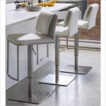 luxurious white  upholstered bar stool  design with stunning metal footrest and rectangle metal base before white bar
