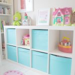 modern and stylish blue and white expedit storage bins design with castle accent on the top aside built in bookshelves