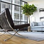 modern barcelona chair knock off in black leather plus stainless steel for contemporary living room in apartment blus grey comfy sofa and glass top coffee table