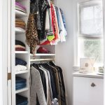 modern white california closets nyc reviews with a lot of shelving and  hanging rods plus persiant rug and wooden floor