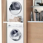 Natural Beige Smallest Stackable Washer Dryer Design With Bookshelves Aside On Glossy Wooden Floor With Recessed Cabinet