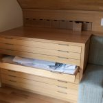 natural wooden flat file cabinet design from ikea with light shape aside gray sofa design on wooden floor