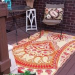 outdoor rugs for decks and patio with world market outdoor rugs with nice seating and round coffee table plus brick wall and hardwood floor