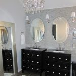 Outstanding Black Storage Vanity Design Beneath Double Round Wall Mirrors Idea And Chandelier And Runner Rug