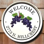 Playful Address Plaques For Home Design With Welcome Writing On Round White Board With Grape Picture And Address Writing And Wooden Wall
