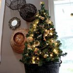 pre lit tabletop christmas trees with cristmast light and golden bauble and pretty christmas ornaments and black pot plus impressive wall decoration