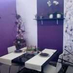 purple paint color for modern dining room light and bold purple wall paint style a pair of white dining chair black dining table a pair of plates small black rug with modern motif some decorative plants