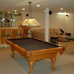 recessed lighting fixtures for basement that is renovated into an open space for home bar game room and  relaxing room
