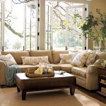 sectional pottery barn sofa reviews in cream with floral cushions and ottoman coffee table plus rug and wooden end table with drawer underneath