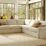 sectional pottery barn sofa reviews in living room with decorative cushions and modern rug and large glass windows and doors