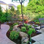 simple landscaping ideas for front of housewith patio with metal bench and stone plus garden ideas with green plant and trees and metal fence