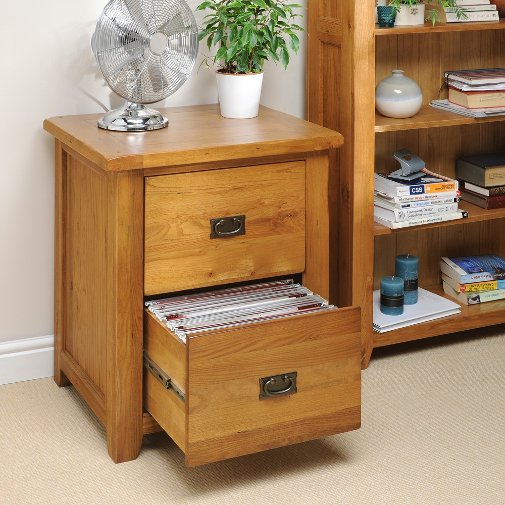 Simple Natural Wooden File Cabinet Ikea Design With Two Drawers And Fan Potted Plant Aside