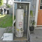 simple outdoor water heater enclosure and utdoor water heater enclosure installed at the backyard