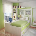 small desks for bedrooms with soft green paint color and comfy bed witt drawer underneath plus rug and wooden floor