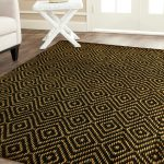 smart patterned black jute rug design with yellow pattern on washed white flooring with white furniture of modern table and sofa