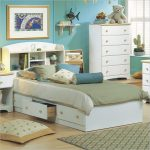soft blue bedroom idea with evening hue bedding sheet of twin bed bed with storage idea with textured rug and chest of drawer