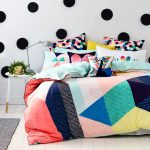 square crop bedding set and duvet covers for teens with polka walpaper and round nightstand with spotlight and hardwood floor