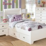stripe patterned wall accent in colorful design with white children twin bed with storage with chest of drawer on wooden floor