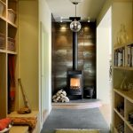 stunning and luxurious corner wood burning stove design in hallway with storage and runner rug with brown wall accent and bulb pendants