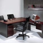 stunning burgundy desk countertop for office with black leather swivel chair facing double bold dark guest chairs