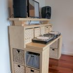 stunning natural cream standing desk for your own office with storage bin and double tops and stereo sound system on wooden floor