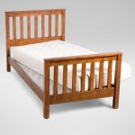 stunning natural wooden deck bedding with white bunkie board style on its top with footboard and headboard