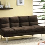 stylish black velvet sofa design that turn into bed with plaid texture beneath cream wall above gray fabric area rug with potted plant and wall storage