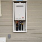 tankless water heater and outdoor water heater enclosure installed on wall