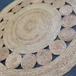 unique and artistic round shaped and textured jute rug idea with ballspattern and chevron pattern for stylish needs