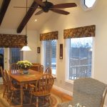 Valances For Sliding Glass Doors In Roman Style With Blinds Window Treatment In Dining Room With Wooden Table And Seating Plus Area Rug On Wooden Floor