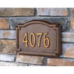 vintage carved address plaques design for homes with molding with golden accent on natural brick wall design with 4076 number