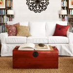 white pottery barn sofa reviews with red decorative cushions and wooden coffee table plus jute rug and bookcases and wall scones