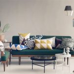 wonderful skandinavian ferm living usa with green sofa and patterned colorful cushions and round black coffee table with pendant lights