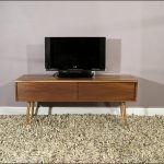 wondrous and simple wooden long media cabinet design with long legs above gray area rug beneath gray painted wall