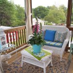 world market outdoor rugs for glass screen porch and patio with vintage bench and coffee table plus decorative elements